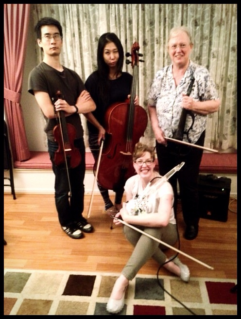 (l to r): Jonathan Sun (violin), Judy Kang (cello), Sarah Wallin Huff (electric 6-string violin), Kay Pech (electric 5-string violin).
